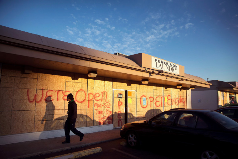 Plywood covers the glass front of a strip mall along West Florissant Street on Nov. 14, 2014 in Ferguson, Mo.