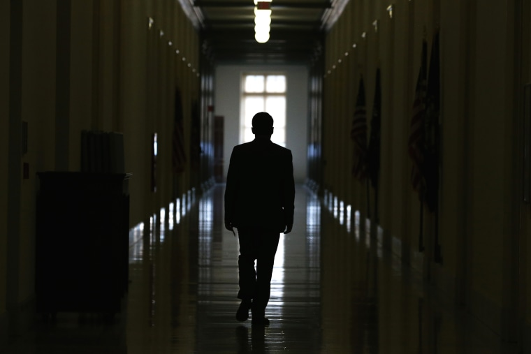 A man is silhouetted as he walks down a hallway in the Cannon House Office Building on Capitol Hill on Nov. 14, 2014 in Washington, D.C. (Photo by Mark Wilson/Getty)