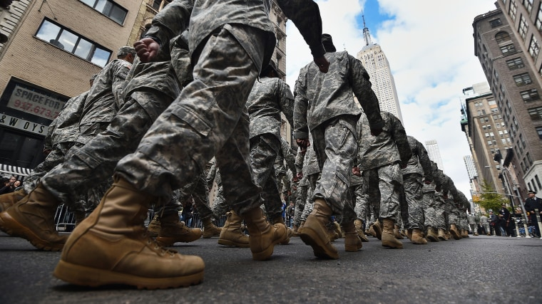 US military soldiers march during the Veterans Day Parade in New York on Nov. 11, 2014. (Photo by Jewel Samad/AFP/Getty)