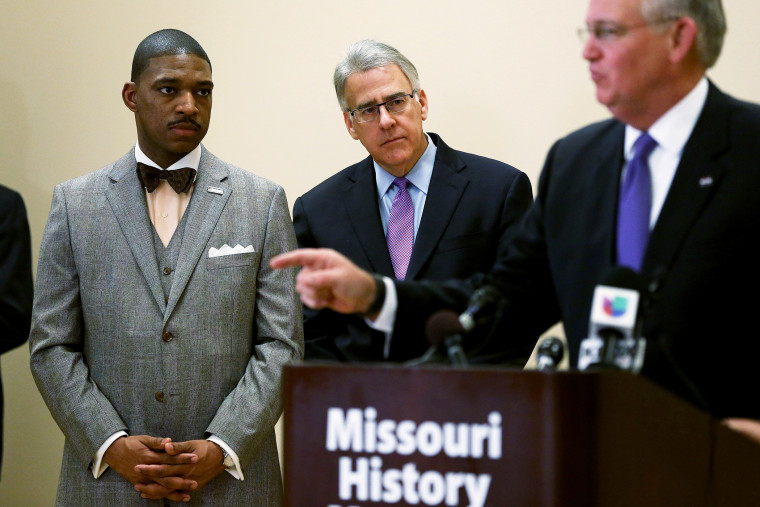 Minister Starsky Wilson (L) and businessman Richard McClure listen as Missouri Governor Jay Nixon, speaks to the media after announcing them as the co-chairs of a 16-member Ferguson Commission on Nov. 18, 2014 in St. Louis, Mo. (Photo by Joe Raedle/Getty)