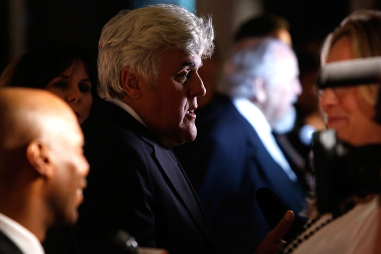 Honoree Jay Leno talks to reporters on the red carpet for the taping of the Mark Twain Prize for Humor ceremony and performance at the Kennedy Center in Washington on Oct. 19, 2014.