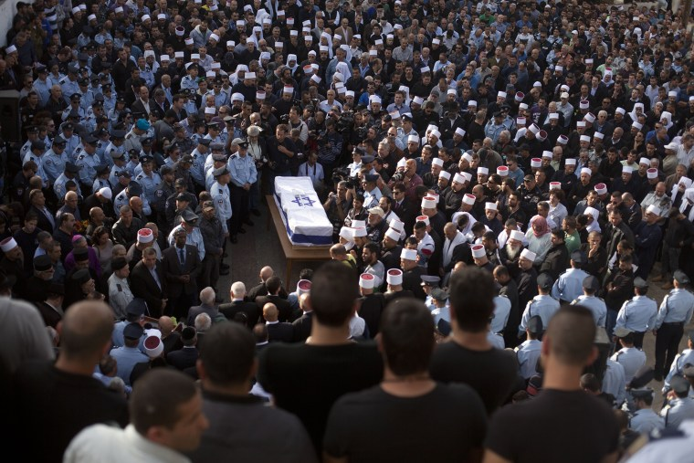 Druze men and relatives attend the funeral of Druze Israeli police officer Zidan Sif on Nov. 19, 2014 in the Druze village of Yanuh-Jat, Israel. (Lior Mizrahi/Getty)
