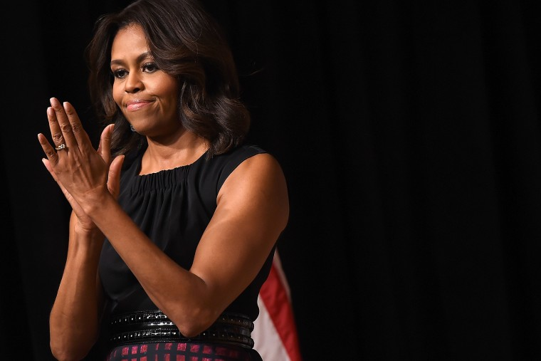 U.S first lady Michelle Obama speaks at an event on Nov. 9, 2014 in Arlington, Va. (Photo by Win McNamee/Getty)