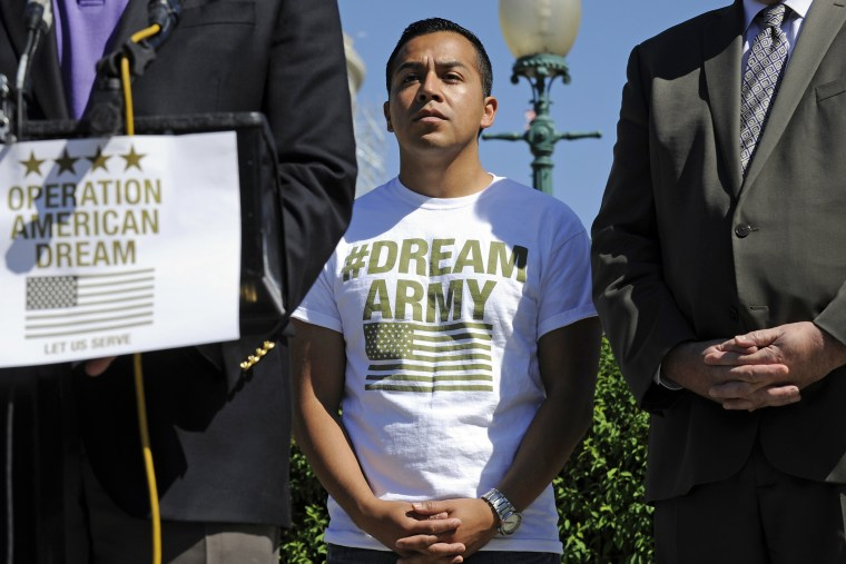 DREAM Action Coalition Co-Director Cesar Vargas, center, participates in a news conference on Capitol Hill in Washington, D.C., July 25, 2014. (Photo by AP)