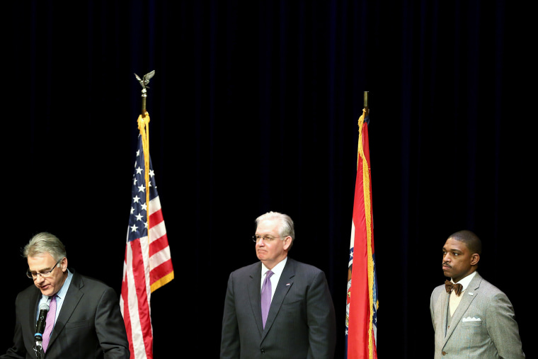 Missouri Governor Jay Nixon (C) stands with businessman Richard McClure (L) and minister Starsky Wilson after he announced them as the co-chairs of a 16-member Ferguson Commission on Nov. 18, 2014 in St. Louis, Mo.