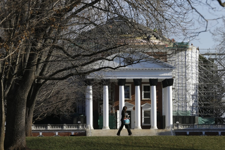 A student walks across the Lawn in front of the Rotunda at the University of Virginia Wednesday on Feb. 20, 2013 in Charlottesville, Va. (Steve Helber/AP)