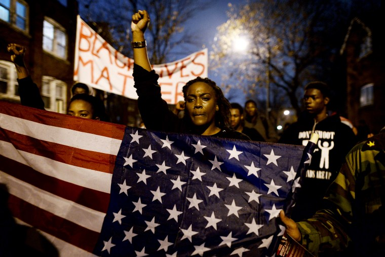 Demonstrators shout slogans during a march in St. Louis, Missouri, on Nov. 23, 2014 to protest the death of 18-year-old Michael Brown.
