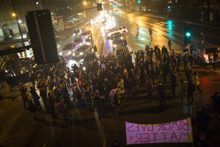Demonstrators block traffic at an intersection as they march through the streets of the Shaw neighborhood, Nov. 23, 2014, in St. Louis, Mo. (Photo by Eric Thayer/The Washington Post/Getty)