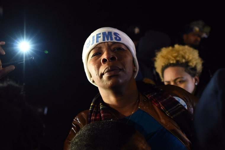 Michael Brown's mother Leslie McSpadden cries outside the police station in Ferguson, Mo. on Nov. 24, 2014 after hearing the grand jury decision on her son's fatal shooting
