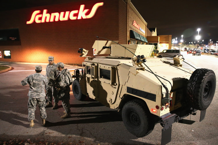 National Guard troops arrive ahead of the grand jury announcement in the Michael Brown shooting case on Nov. 24, 2014 in Ferguson, Mo. (Photo by Scott Olson/Getty)