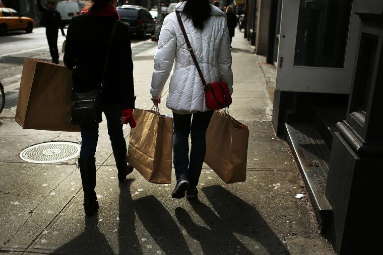 Women walk down Broadway with shopping bags on Feb. 7, 2013 in New York, N.Y. (Photo by Spencer Platt/Getty)