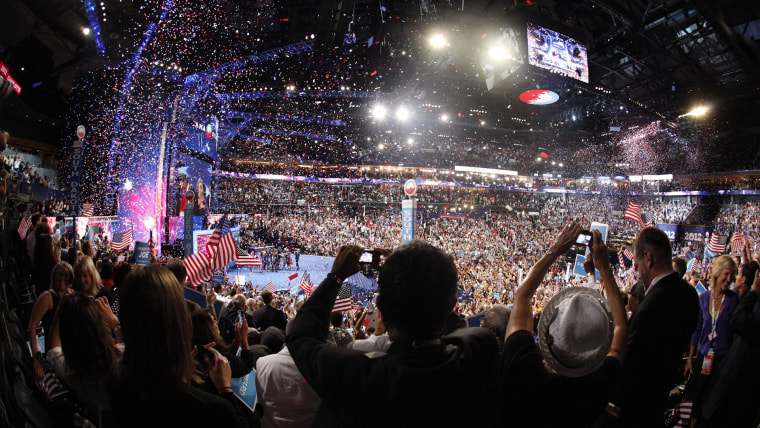 Delegates cheer as President Barack Obama is joined on stage by his family at the conclusion of the final session of the Democratic National Convention in Charlotte, North Carolina, Sept. 6, 2012.