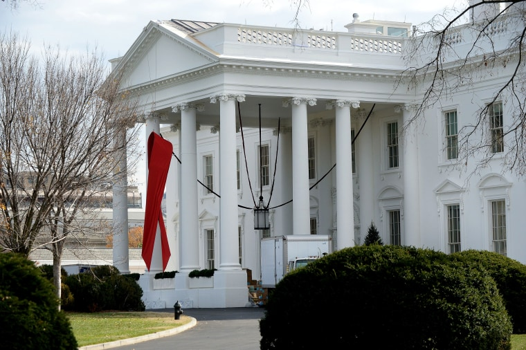 A red ribbon is displayed on the North Portico of the White House, December 1, 2014, to commemorate World AIDS Day.