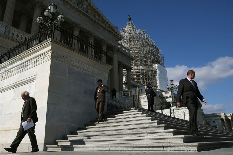 Members walk down the steps of the House side of the US Capitol after voting on the Keystone XL Pipeline, Nov. 14, 2014 in Washington, DC.