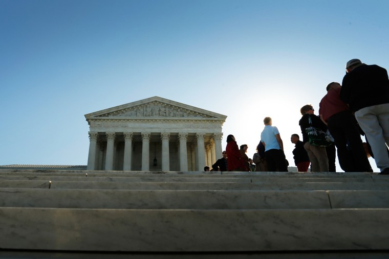 Visitors stand in line to watch arguments on the first day of the new term of the U.S. Supreme Court in Washington on Oct. 6, 2014. (Photo by Jonathan Ernst/Reuters)