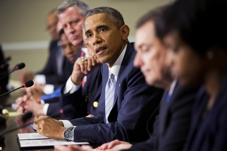 President Barack Obama, center, speaks during his meeting with elected officials, law enforcement officials and community and faith leaders in Washington, D.C., Dec. 1, 2014. (Photo by Pablo Martinez Monsivais/AP)