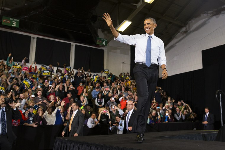 President Barack Obama waves after being introduced during an event on Oct. 30, 2014, in Portland, Maine. (Photo by Evan Vucci/AP)