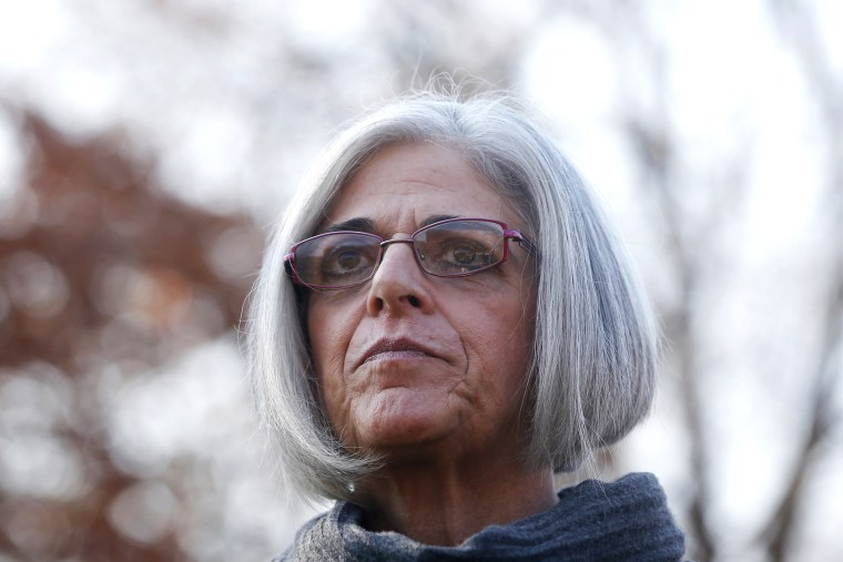 Judy Gross, wife of Alan Gross, joins other supporters at an event to mark his fourth year in prison in Cuba in Lafayette Park across from the White House in Washington, D.C. on Dec. 3, 2013. (Photo by Charles Dharapak/AP)