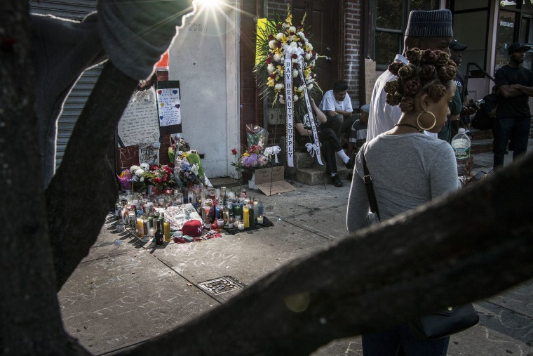 A memorial for Eric Garner at the site where he died is seen on July 20, 2014 in Staten Island, N.Y. (Photo by Mark Peterson/Redux)