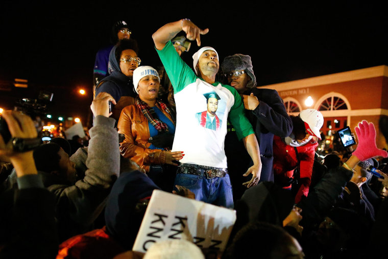 The mother of Michael Brown, Lesley McSpadden, (2-L) and her husband Louis Head gesture after the announced decision by the Grand Jury in Ferguson Mo. on Nov. 24, 2014.