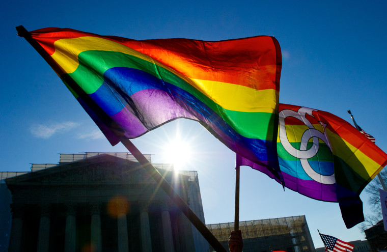 Gay pride flags flying at the US Supreme Court on March 27, 2013 in Washington, DC.