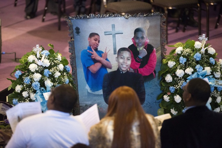 Family and friends sit and listen to kinds words being spoke during a memorial set up for Tamir Rice during the memorial ceremony for Tamir Rice, at the Mt. Sinai Baptist CHurch in Cleveland on Wednesday, Dec. 3, 2014.