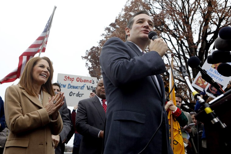 U.S. Rep. Michele Bachmann (R-MN) reacts as Senator Ted Cruz (R-TX) speaks on Capitol Hill in Washington, Dec. 3, 2014.