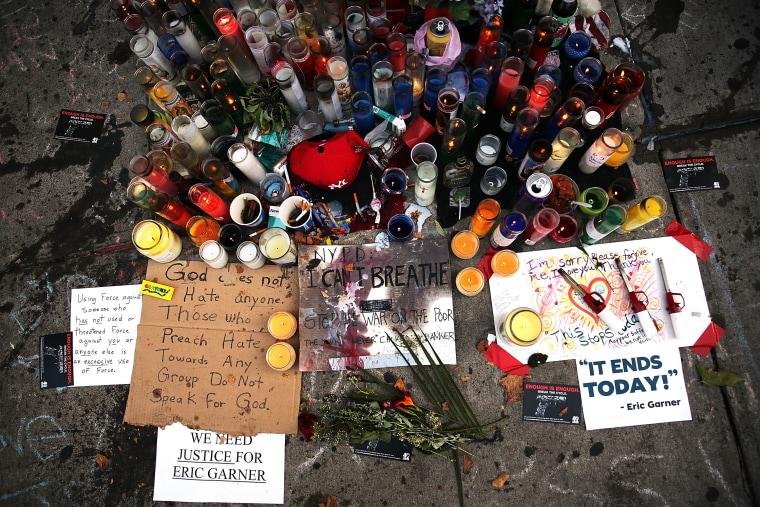 A growing memorial is viewed for Eric Garner near where he died after he was taken into police custody in Staten Island last Thursday on July 22, 2014 in New York City.