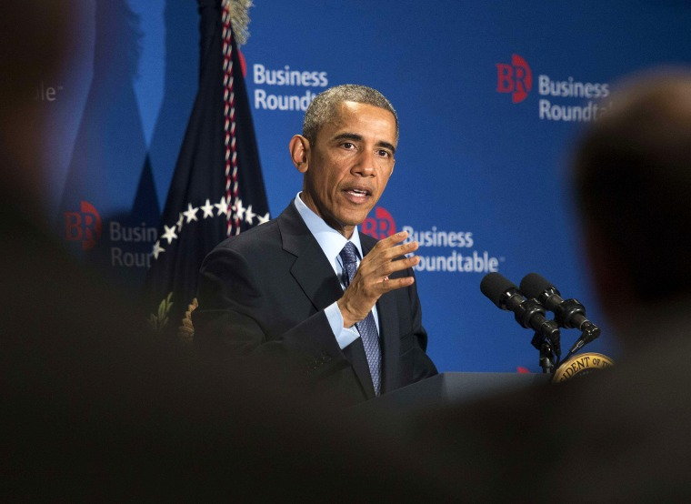 President Barack Obama addresses a group of business leaders at the quarterly meeting of the Business Roundtable in Washington, D.C. on Dec. 3, 2014. (Photo by Nicholas Kamm/AFP/Getty)