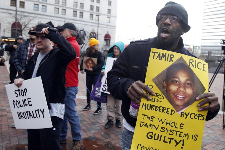 Protesters march during a rally at Public Square in Cleveland, Ohio on Nov. 24, 2014, following the November 22 fatal shooting of 12 year old Tamir Rice by a Cleveland Police officer. (Photo by David Maxwell/EPA)
