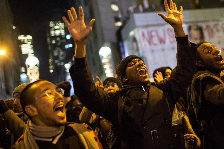 People take part in a protest against the grand jury decision on the death of Eric Garner in midtown Manhattan in New York, N.Y. on Dec. 3, 2014. (Photo by Eric Thayer/Reuters)