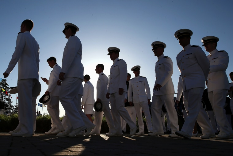 U.S. Naval Academy midshipmen gather before graduation ceremonies on May 23, 2014 in Annapolis, Md.