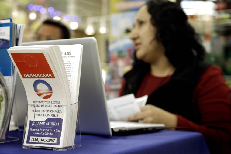 Blue Bridge Benefits LLC agent Patricia Sarabia helps customers interested in Obama Care at a kiosk at Compare Foods in Winston-Salem, N.C. on Nov. 22, 2014.