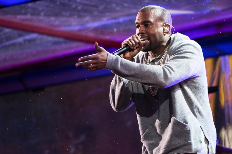 Kanye West performs in Times Square on Dec. 1, 2014 in New York, N.Y. (Photo by Charles Sykes/Invision/AP)