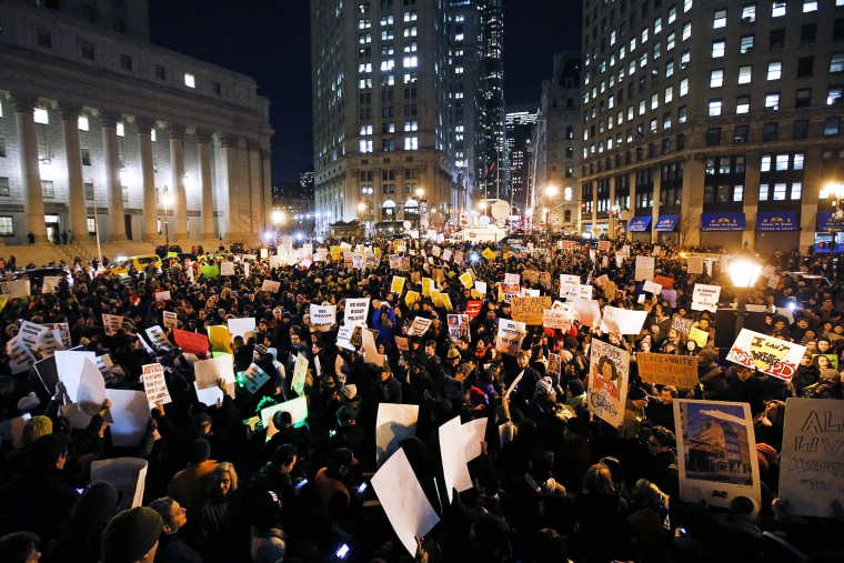 Protesters rally against a grand jury's decision not to indict the police officer involved in the death of Eric Garner in Foley Square, Dec. 4, 2014, in New York, N.Y. (Photo by Jason DeCrow/AP)