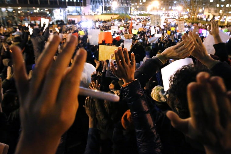 Protesters rally against a grand jury's decision not to indict the police officer involved in the death of Eric Garner in Foley Square, Dec. 4, 2014, in New York.