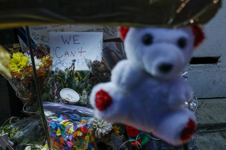 Image: A sign is seen at a makeshift memorial where Garner died during an arrest in July in the Staten Island borough of New York