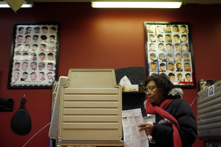 A voter casts her ballot for the U.S. midterm elections at a beauty salon used as a polling station in Chicago on Nov. 4, 2014
