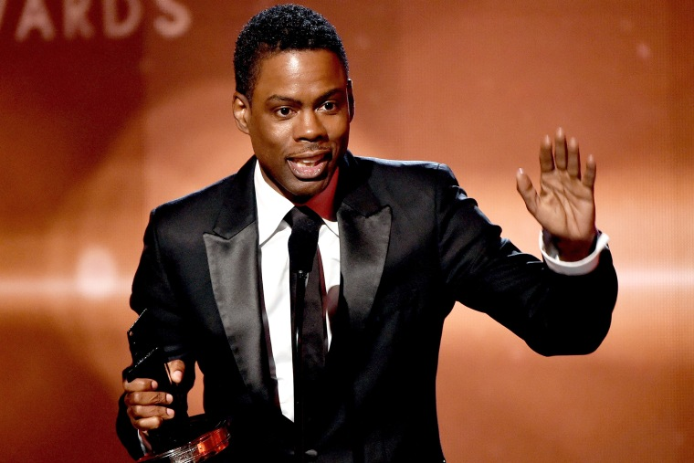 Actor-comedian Chris Rock accepts the Hollywood Comedy Film Award for 'Top Five' onstage during the 18th Annual Hollywood Film Awards on Nov. 14, 2014 in Hollywood, Calif. (Photo by Kevin Winter/Getty)