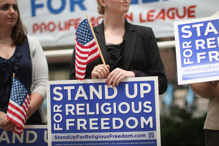Religious freedom supporters hold a rally to praise the Supreme Court's decision in the Hobby Lobby contraception coverage requirement case on June 30, 2014 in Chicago, Ill. (Scott Olson/Getty)