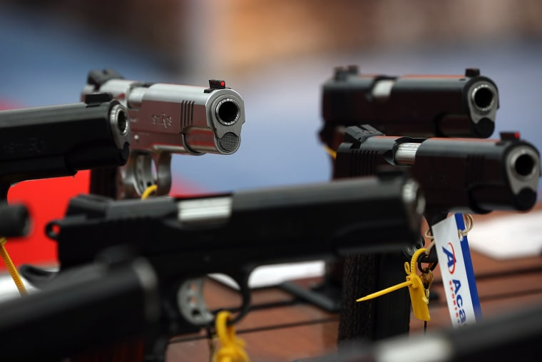 Handguns are displayed in the Remington booth during the 2013 NRA Annual Meeting and Exhibits at the George R. Brown Convention Center on May 5, 2013 in Houston, Texas. (Justin Sullivan/Getty)