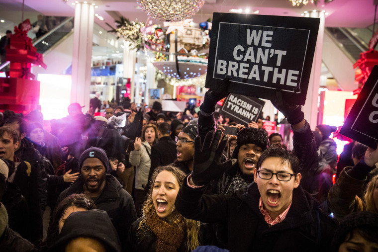 Demonstrators storm the Macy's on 34th Street protesting the Staten Island, N.Y. grand jury's decision not to indict a police officer involved in the chokehold death of Eric Garner in July on Dec. 5, 2014 in New York City. (Andrew Burton/Getty)