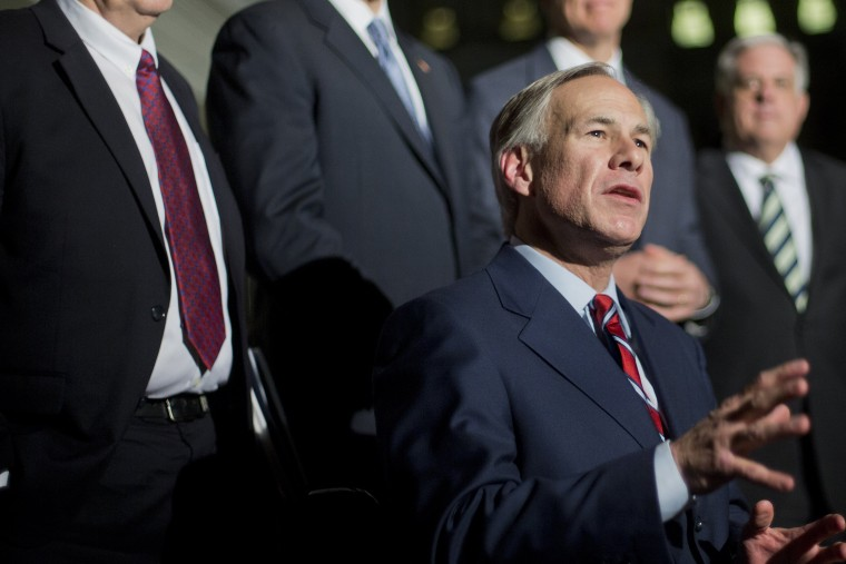Texas Gov.-elect Greg Abbott speaks to member of the media following a meeting with President Barack Obama and newly elected governors at the White House on Dec. 5, 2014. (Pablo Martinez Monsivais/AP)