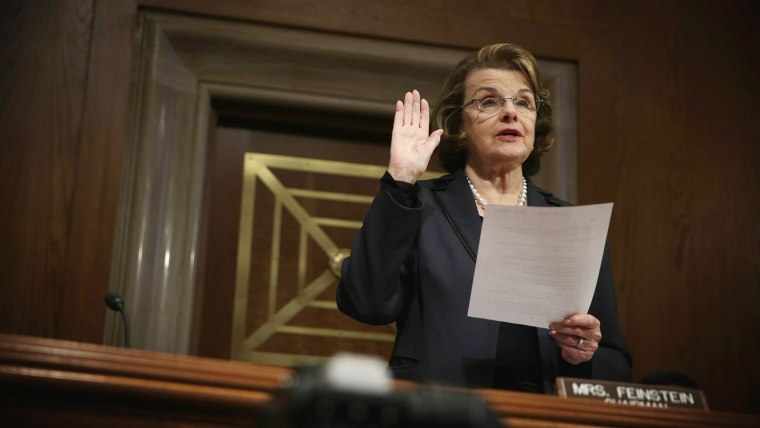 Committee Chairman Sen. Dianne Feinstein (D-CA) administers the oath for Acting Director at the National Counterterrorism Center Nicholas Rasmussen during his confirmation hearing before the Senate (Select) Intelligence Committee on Nov. 20, 2014 on Capit