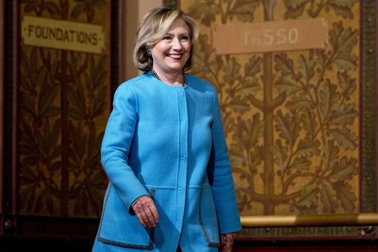 Former Secretary of State Hillary Rodham Clinton arrives to speak in Gaston Hall at Georgetown University in Washington, D.C., Dec. 3, 2014. (Photo by Carolyn Kaster/AP)
