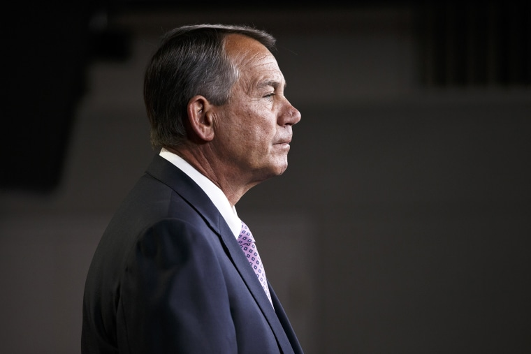 House Speaker John Boehner of Ohio meets with reporters on Capitol Hill in Washington, D.C., Dec. 4, 2014. (Photo by J. Scott Applewhite/AP)