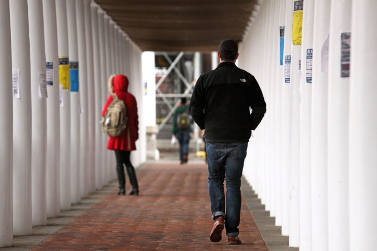 Students walk through an outdoor corridor on the on the University of Virginia campus on Dec. 6, 2014 in Charlottesville, Va. (Photo by Jay Paul/Getty)