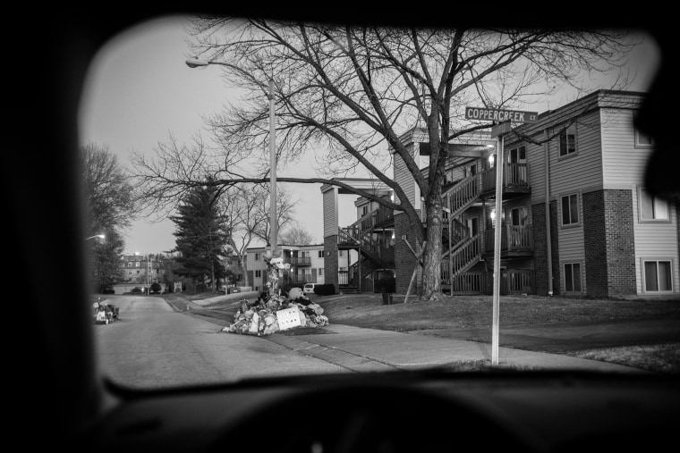 A view through a car window of the street in front of the Canfield apartment complex where teenager Michael Brown was shot and killed is seen on Nov. 28, 2014 in Ferguson, Mo. (Photo by David Butow/Redux)