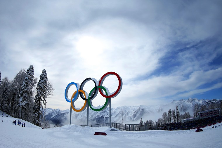 Mist rises behind the Olympic Rings during day 12 of the Sochi 2014 Winter Olympics on Feb. 19, 2014 in Sochi, Russia. (Photo by Julian Finney/Getty)