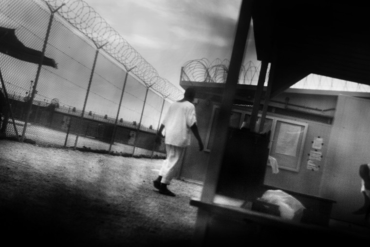 Detainees in are seen camp 4 of Guantanamo Bay in June 2006. (Photo by Paolo Pellegrin/Magnum)